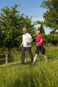 11529792-nordic-walking--happy-mature-or-senior-couple-doing-sports-in-summer-outdoors